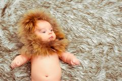Adorable little baby in a fur hat Stock Images