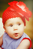 Adorable little baby girl with big eyes Stock Photos