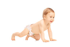 Adorable little baby girl crawling on the floor Stock Photo