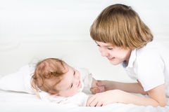 Adorable little baby girl with her big brother Stock Photo
