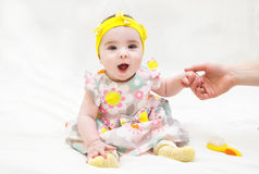 Adorable little baby girl laughing, creeping and playing in the studio. Isolated on white background royalty free stock photos