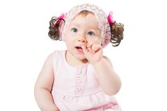 Adorable little baby girl  playing in the studio, isolated on white background. Stock Photography