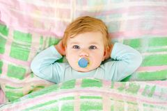 Adorable little baby girl sleeping in bed. Calm peaceful child dreaming during day sleep. Beautiful baby in parents bed. Sleeping together concept stock image