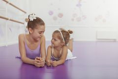 Charming two young ballerinas practicing at ballet class stock photo