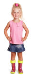 Adorable little blond girl in blouse, skirt, rubber boots isolated. royalty free stock images