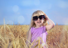 Adorable little blond girl in huge sunglasses Royalty Free Stock Photo