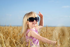 Adorable little blond girl in huge sunglasses Stock Image