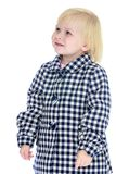 Adorable little blonde girl in a checkered coat Royalty Free Stock Photo