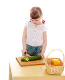 Adorable little blonde girl cut with a knife Royalty Free Stock Image