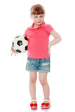 Adorable little blonde girl in denim shorts and Royalty Free Stock Images