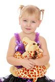 Adorable little blonde girl with pigtails on her Royalty Free Stock Images