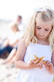 Adorable Little Blonde Girl with Starfish Royalty Free Stock Images