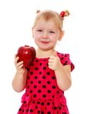 Adorable little blonde with a red Apple in his Stock Images