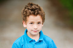 Adorable little boy. Closeup of an adorable five year old boy outdoors Stock Image