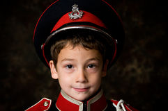 Adorable little boy. Close up of a six year old boy wearing a marching band uniform Royalty Free Stock Photography