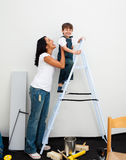 Adorable little boy climbing a ladder Royalty Free Stock Photography
