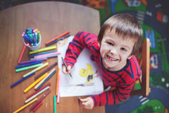 Adorable little boy, drawing picture for easter Stock Photography