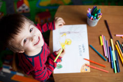 Adorable little boy, drawing picture for easter Royalty Free Stock Photos