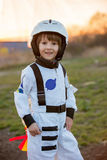 Adorable little boy, dressed as astronaut, playing in park Royalty Free Stock Images