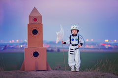 Adorable little boy, dressed as astronaut, playing in the park w Royalty Free Stock Photography