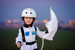 Adorable little boy, dressed as astronaut, playing in the park w Stock Photography