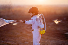Adorable little boy, dressed as astronaut, playing in the park w Stock Photo