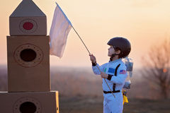 Adorable little boy, dressed as astronaut, playing in the park w Royalty Free Stock Photo