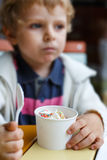 Adorable little boy eating frozen yoghurt ice cream in cafe Stock Photos