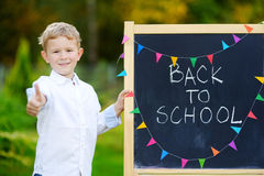 Adorable little boy feeling exited about going back to school Stock Photos