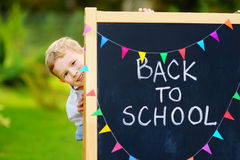 Adorable little boy feeling exited about going back to school Stock Photo