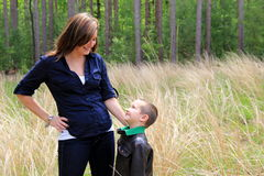 Adorable little boy gazing up his smiling mom Royalty Free Stock Photography