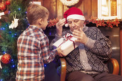Adorable little boy gives a christmas gift Stock Photography