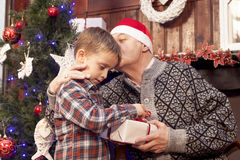 Adorable little boy gives a christmas gift Royalty Free Stock Images