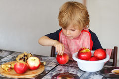 Adorable little boy helping and baking apple pie in home''s kitc Stock Photo