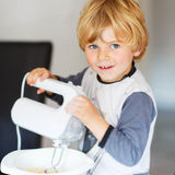 Adorable little boy helping and baking pie Royalty Free Stock Photos