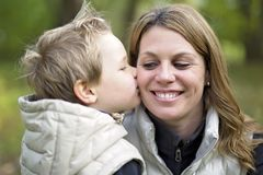 Adorable little boy with his mother in autumn park Stock Images