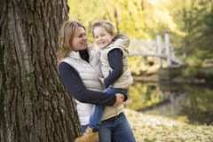 Adorable little boy with his mother in autumn park Royalty Free Stock Images
