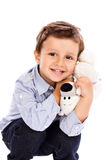 Adorable little boy holding  his favourite toy Royalty Free Stock Photos