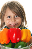 Adorable little boy holding peppers Royalty Free Stock Photo