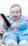 Adorable little boy holding remote control Stock Images