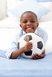Adorable little boy holding a soccer ball Royalty Free Stock Images