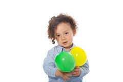 Adorable little boy holding two balloons, on white Stock Images