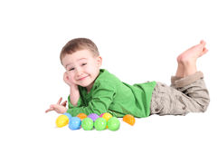Adorable little boy lying down with colourful East Stock Image