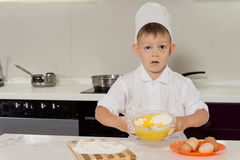 Adorable little boy pastry chef Stock Photos