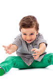 Adorable little boy playing on the floor Royalty Free Stock Photo