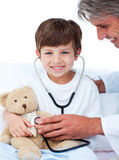 Adorable Little boy playing with his doctor Royalty Free Stock Photography