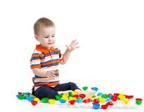 Child playing mosaic toy Stock Photo