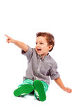 Adorable little boy pointing at something Royalty Free Stock Images