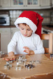 Adorable little boy, preparing cookies for christmas Stock Images