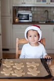 Adorable little boy, preparing cookies for christmas Royalty Free Stock Images